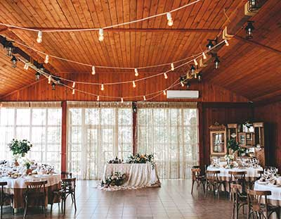 A barn banquet hall with gleaming wood floors
