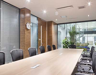 A sparkling clean office conference room with brick and glass walls